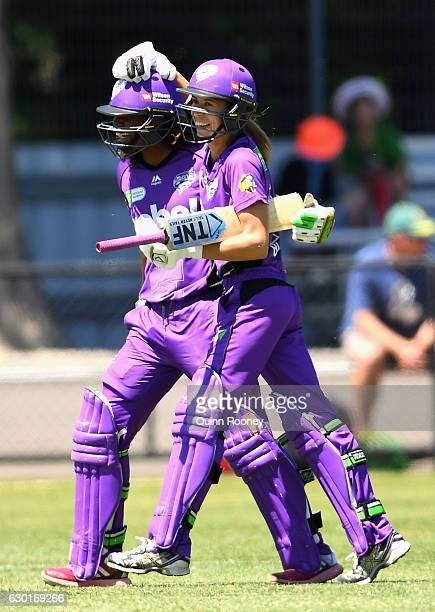 Erin Burns of the Hurricanes is congratulated by Hayley Matthews after hitting the winning runs in the super over during the WBBL match between the...