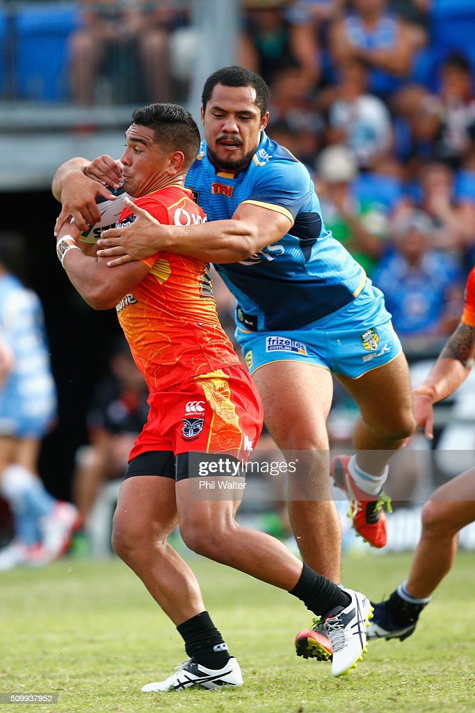 Erin Clark of the Warriors is tackled by Kurt Bernard of the Titans during the NRL Trial Match between the New Zealand Warriors and the GOld Coast Titans at Toll Stadium on February 13, 2016 in Whangarei, New Zealand.