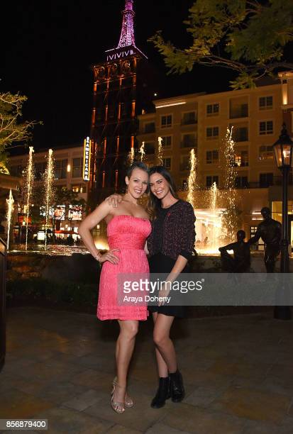 Erin Cummings and Odette Annable 'Go Pink' to light The Americana at Brand's spire support Breast Cancer Awareness Month and the American Cancer...