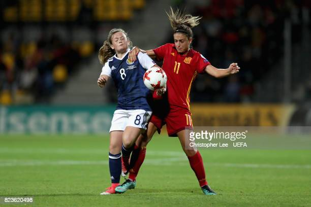 Erin Cuthbert of Scotland and Alexia Putellas of Spain battle for possession during the Group D match between Scotland and Spain during the UEFA...