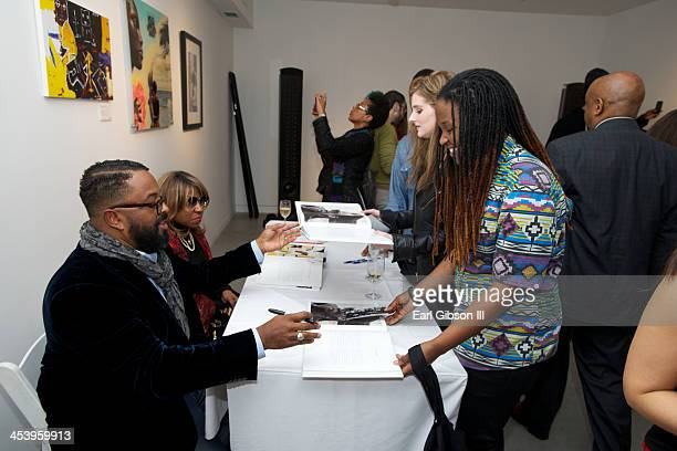 Erin Davis and Cheryl Davis sign books at the 'Miles Davis The Collecte Artwork' Holiday PopUp Gallery at Gallery 151 on December 5 2013 in New York...