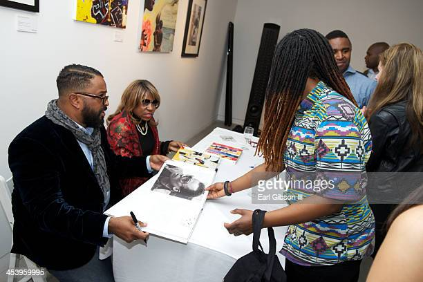 Erin Davis and Cheryl Davis sign books at the 'Miles Davis The Collected Artwork' Holiday PopUp Gallery at Gallery 151 on December 5 2013 in New York...