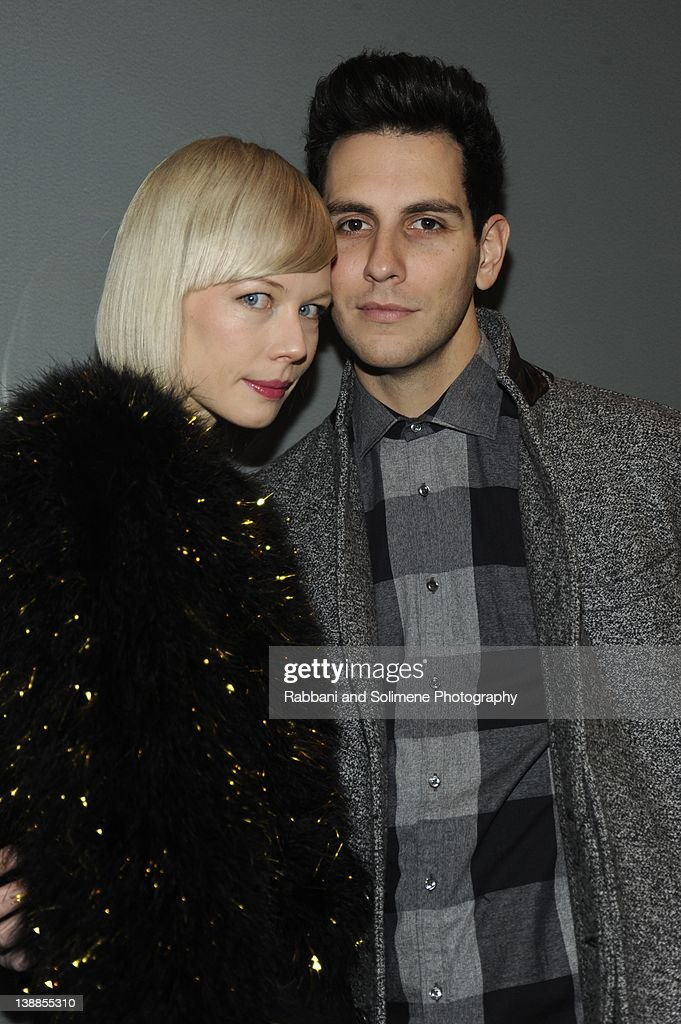 Erin Fetherston and <a gi-track='captionPersonalityLinkClicked' href=/galleries/search?phrase=Gabe+Saporta&family=editorial&specificpeople=4214209 ng-click='$event.stopPropagation()'>Gabe Saporta</a> backstage at the Simon Spurr fall 2012 fashion show during Mercedes-Benz Fashion Week at Milk Studios on February 12, 2012 in New York City.