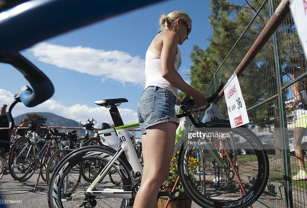 Erin Furness of New Zealand racks her bike during the Challenge Penticton Triathlon previews on August 24, 2013 in Penticton, British Columbia, Canada.