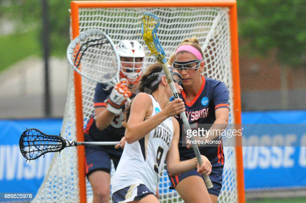 Erin Harvey of College of New Jersey is defended by Ali Gorab of Gettysburg College during the Division III Women's Lacrosse Championship held at...
