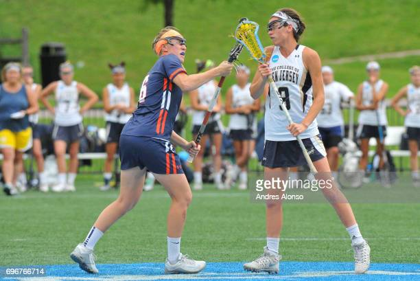 Erin Harvey of the College of New Jersey and Caroline Jaeger of Gettysburg College faceoff during the Division III Women's Lacrosse Championship held...