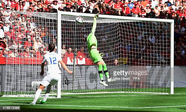 Erin McLeod of Canada fails to top a header from Lucy Bronze of England during the FIFA Women's World Cup 2015 Quarter Final match between England...