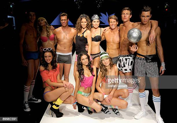 Erin McNaught and Zoe Naylor with models showcase designs by various designers from the Hot In The City lingerie show on the catwalk at Rosemount...