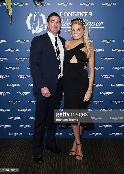 Erin Molan and Sean Ogilvy pose during Golden Slipper Day at Rosehill Gardens on March 19 2016 in Sydney Australia