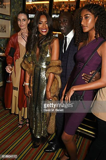 Erin O'Connor Naomi Campbell Ozwald Boateng and Emilia Boateng attend Edward Enninful's OBE dinner at Mark's Club on October 27 2016 in London England