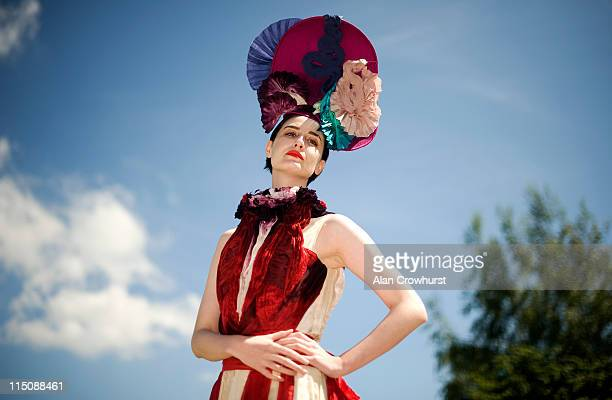 Erin O'Connor supermodel wearing a bespoke creation by official milliner Louis Mariette and dress designed by Felicity Brown during The Derby...