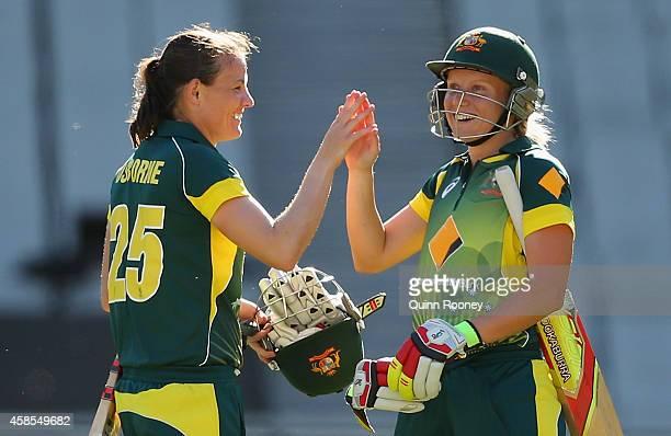 Erin Osborne and Alyssa Healy of Australia celebrate winning game three of the International Women's Twenty20 match between Australia and the West...