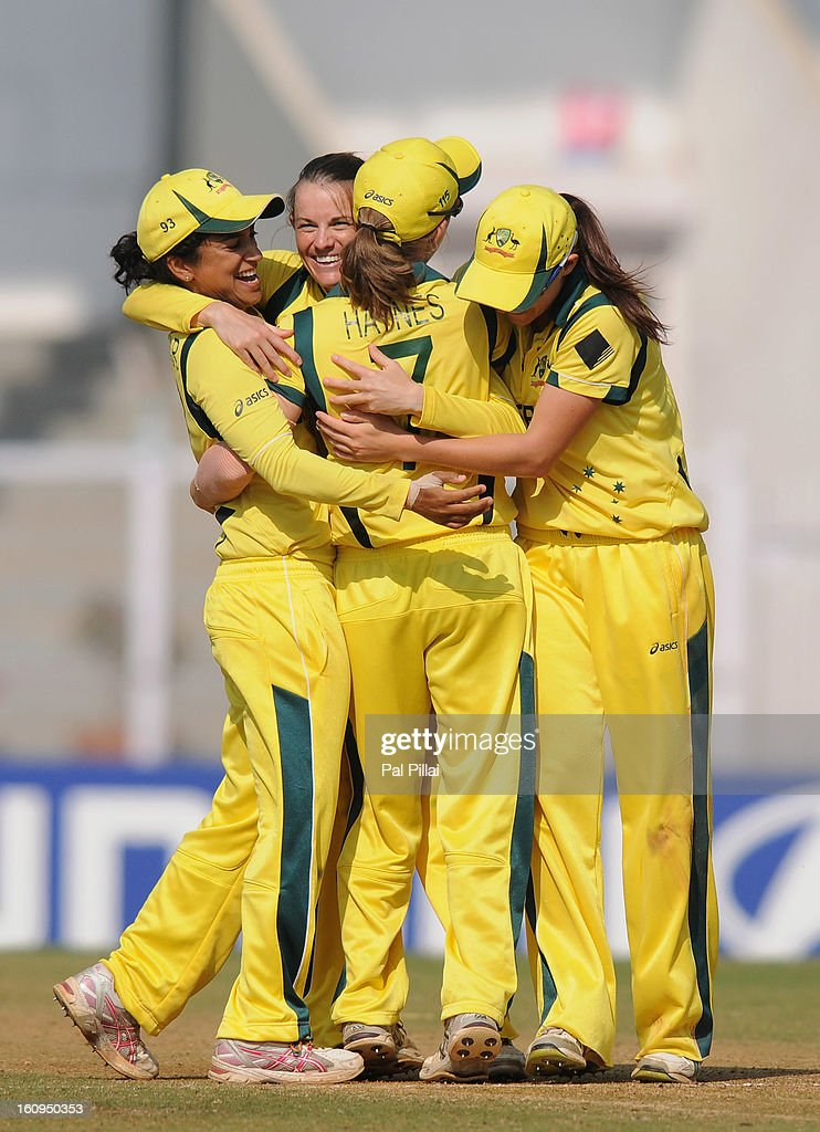 Erin Osborne of Australia and Lisa Sthalekar celebrate with teammate after winning the super six match between England and Australia held at the CCI (Cricket Club of India) on February 8, 2013 in Mumbai, India.