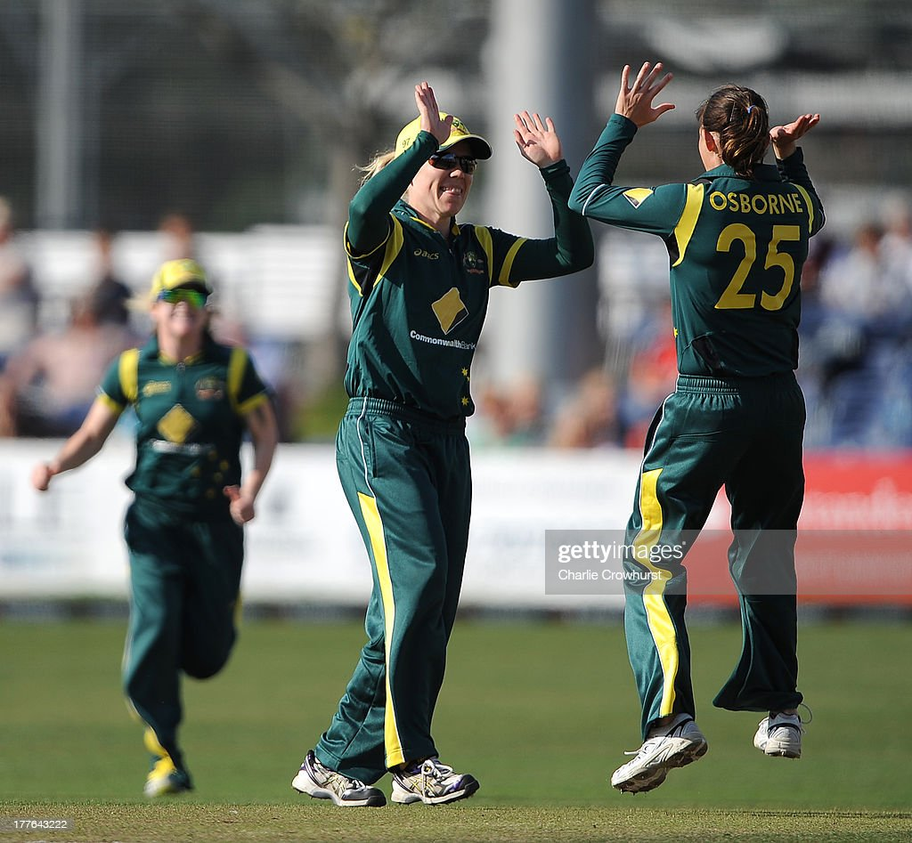Erin Osborne of Australia celebrates a wicket with team mate <a gi-track='captionPersonalityLinkClicked' href=/galleries/search?phrase=Alex+Blackwell&family=editorial&specificpeople=198941 ng-click='$event.stopPropagation()'>Alex Blackwell</a> during the England Women and Australia Women Ashes Series - 3rd NatWest ODI at The BrightonandHoveJobs.com County Ground on August 25, 2013 in Hove, England.