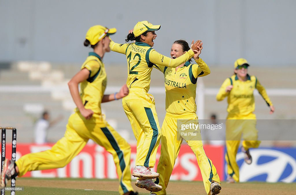 Erin Osborne of Australia celebrates with teammate <a gi-track='captionPersonalityLinkClicked' href=/galleries/search?phrase=Lisa+Sthalekar&family=editorial&specificpeople=178307 ng-click='$event.stopPropagation()'>Lisa Sthalekar</a> after winning the super six match between England and Australia held at the CCI (Cricket Club of India) on February 8, 2013 in Mumbai, India.