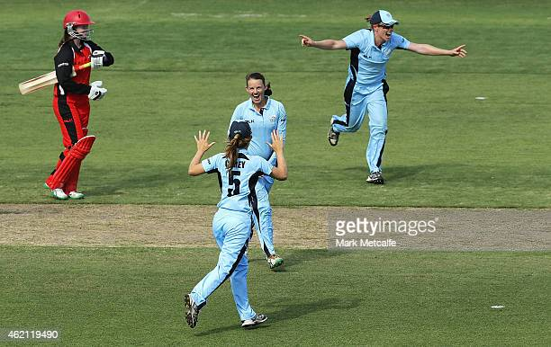 Erin Osborne of the Breakers celebrates with team mates after taking the wicket of Alex Price of the Scorpions to win the WNCL Final match between...