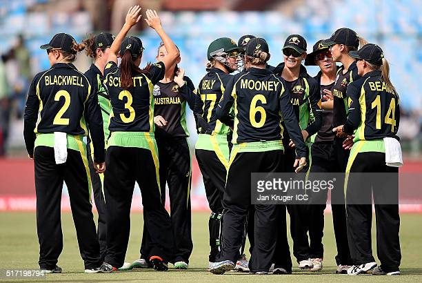 Erin Osbourne of Australia celebrates the wicket of Yasoda Mendis of Sri Lanka with team mates during the Women's ICC World Twenty20 India 2016 match...