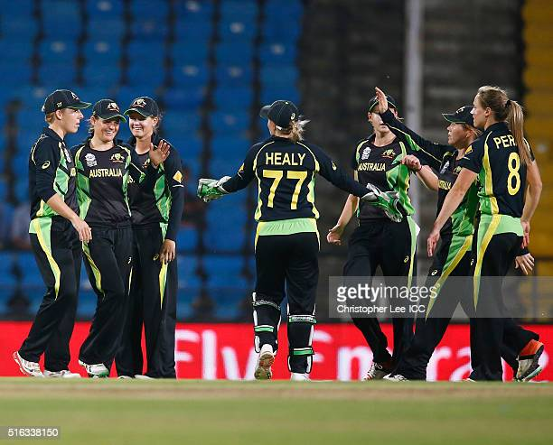 Erin Osbourne of Australia is congratulated after taking the catch of Marizanne Kapp of South Africa during the Women's ICC World Twenty20 India 2016...