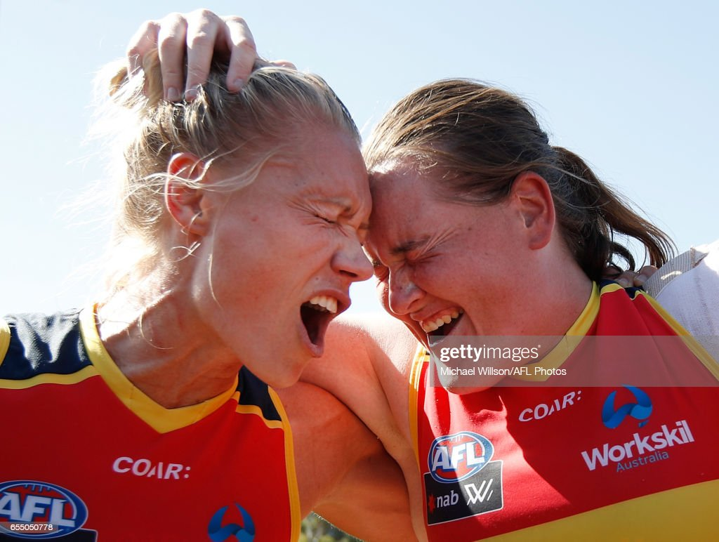 Erin Phillips (left) and Sarah Perkins of the Crows sing the team song during the 2017 AFLW Round 07 match between the Collingwood Magpies and the Adelaide Crows at Olympic Park Oval on March 19, 2017 in Melbourne, Australia.