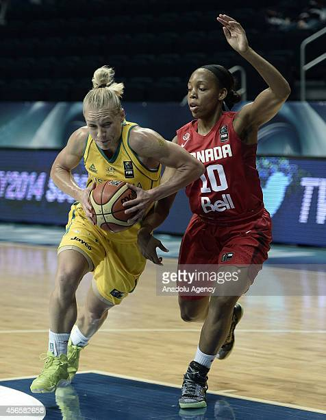 Erin Phillips of Australia in action against Nirra Fields of Canada during 2014 FIBA World Championship For Women quarter final match between Canada...