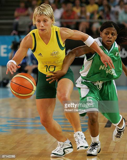 Erin Phillips of Australia is challenged by Tamunomiete Whyte of Nigeria during the Women's Semi Final Basketball match between Australia and Nigeria...