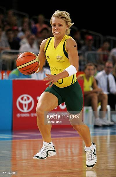 Erin Phillips of Australia takes the ball up court during the gold medal basketball match between Australia and New Zealand at the Multi Purpose...