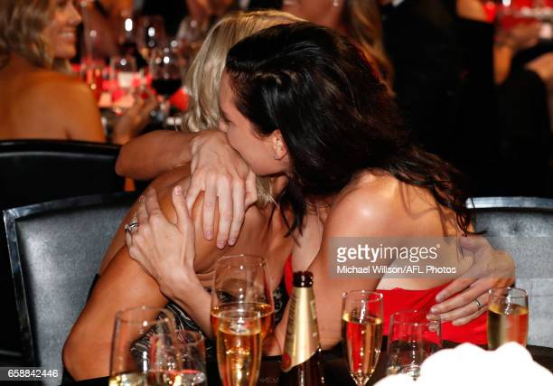 Erin Phillips of the Crows and wife Tracy Gahan embrace after Phillips was announced as the inaugural AFLW Best and Fairest winner during the The W...