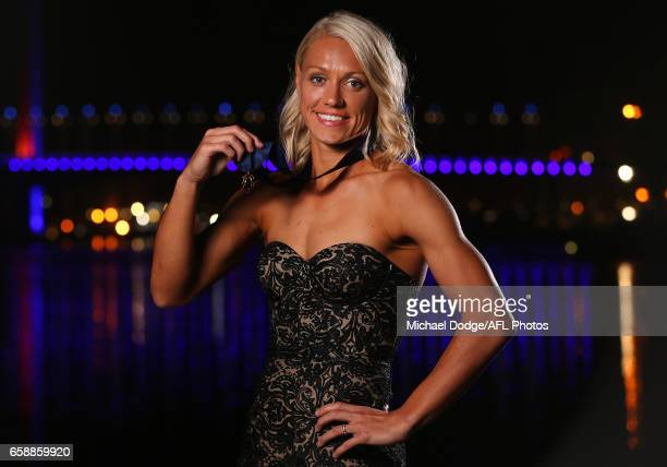 Erin Phillips of the Crows poses for a photograph after being announced as the inaugural winner of the AFLW Best Fairest during the The W Awards at...