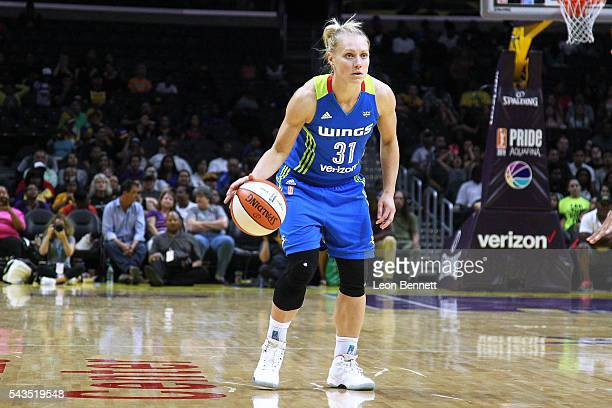 Erin Phillips of the Dallas Wings handles the ball against the Los Angeles Sparks during a WNBA basketball game at Staples Center on June 28 2016 in...