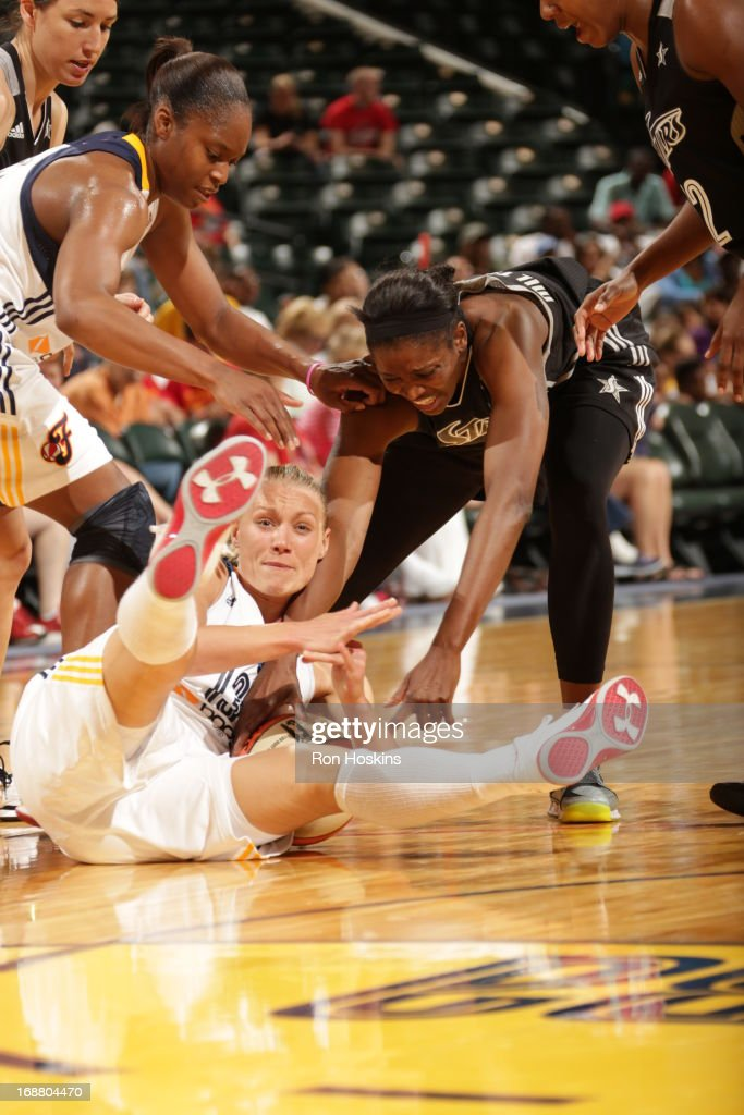 Erin Phillips #13 of the Indiana Fever calls time-out as DeLisha Milton-Jones #1 of the San Antonio Silver Stars tries to tie-up Phillips on May 13, 2013 at Bankers Life Fieldhouse in Indianapolis, Indiana.