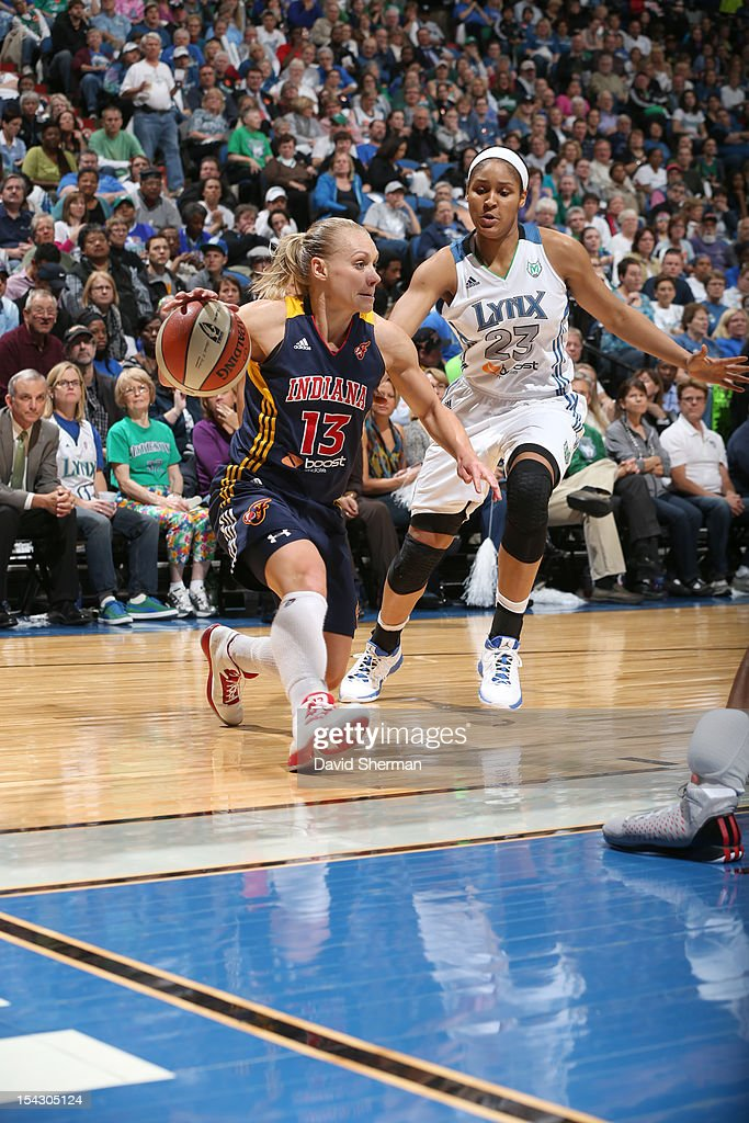 Erin Phillips #13 of the Indiana Fever dribbles the ball against <a gi-track='captionPersonalityLinkClicked' href=/galleries/search?phrase=Maya+Moore&family=editorial&specificpeople=4215914 ng-click='$event.stopPropagation()'>Maya Moore</a> #23 of the Minnesota Lynx during the 2012 WNBA Finals Game Two on October 17, 2012 at Target Center in Minneapolis, Minnesota.