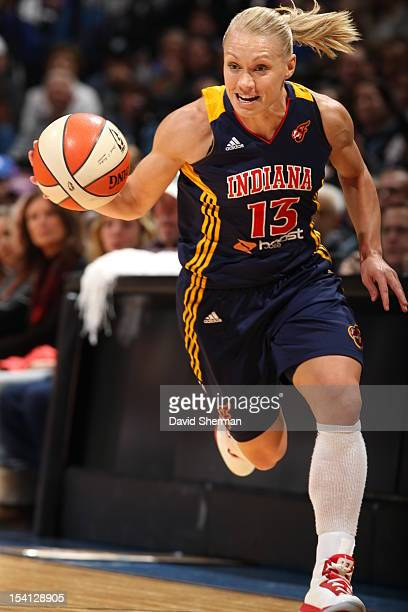 Erin Phillips of the Indiana Fever dribbles the ball up the court against the Minnesota Lynx during the 2012 WNBA Finals Game One on October 14 2012...