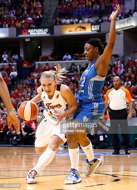 Erin Phillips of the Indiana Fever dribbles through the lane as Monica Wright of the Minnesota Lynx defends during Game Three of the 2012 WNBA Finals...