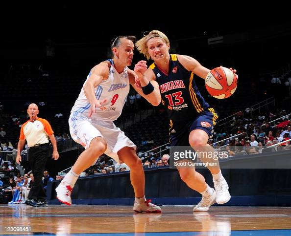 Erin Phillips of the Indiana Fever drives against Coco Miller of the Atlanta Dream at Philips Arena on August 30 2011 in Atlanta Georgia NOTE TO USER...