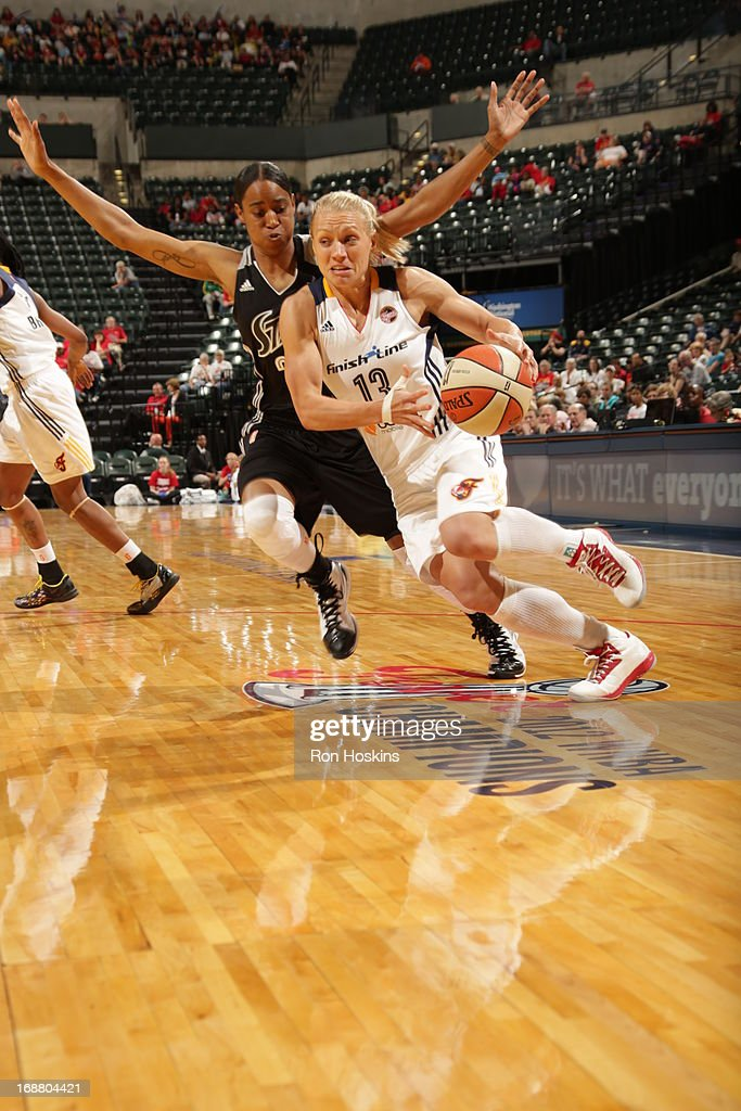 Erin Phillips #13 of the Indiana Fever drives on San Antonio Silver Stars defender on May 13, 2013 at Bankers Life Fieldhouse in Indianapolis, Indiana.