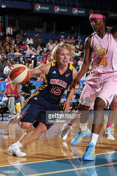 Erin Phillips of the Indiana Fever drives past Sylvia Fowles of the Chicago Sky during the WNBA game on August 7 2011 at the AllState Arena in...