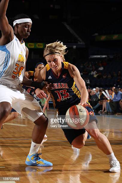 Erin Phillips of the Indiana Fever drives past Sylvia Fowles of the Chicago Sky during the WNBA game on September 4 2011 at the AllState Arena in...
