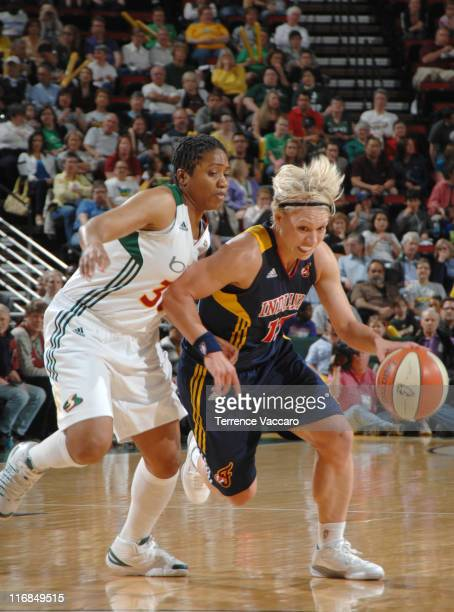 Erin Phillips of the Indiana Fever drives to the basket against Tanisha Wright of the Seattle Storm during the game on June 17 2011 at Key Arena in...
