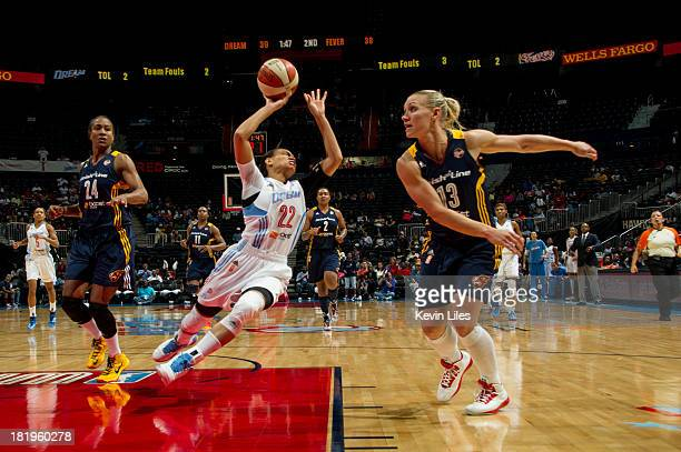 Erin Phillips of the Indiana Fever fouls Armintie Herrington of the Atlanta Dream during the first half at Philips Arena on September 26 2013 in...
