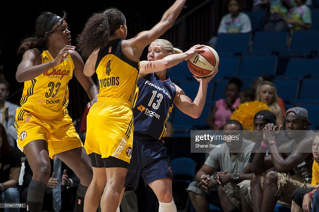 Erin Phillips # 13 of the Indiana Fever is pressured by <a gi-track='captionPersonalityLinkClicked' href=/galleries/search?phrase=Skylar+Diggins&family=editorial&specificpeople=5791961 ng-click='$event.stopPropagation()'>Skylar Diggins</a> # 4 of the Tulsa Shock during the WNBA game on July 25, 2013 at the BOK Center in Tulsa, Oklahoma.