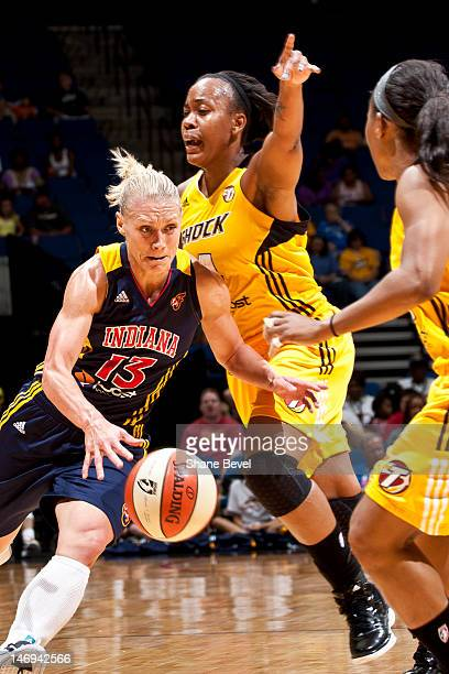 Erin Phillips of the Indiana Fever moves the ball against Amber Holt of the Tulsa Shock during the WNBA game on June 23 2012 at the BOK Center in...