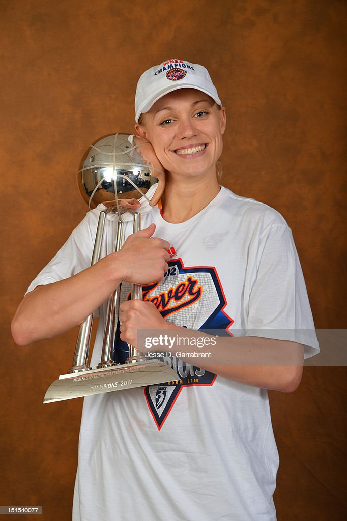 Erin Phillips #13 of the Indiana Fever poses for portraits with the Championship Trophy after Game four of the 2012 WNBA Finals on October 21, 2012 at Bankers Life Fieldhouse in Indianapolis, Indiana.