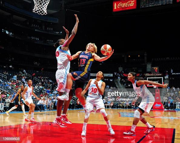 Erin Phillips of the Indiana Fever puts up a shot against Sancho Lyttle of the Atlanta Dream in Game Two of the Eastern Conference Finals during the...