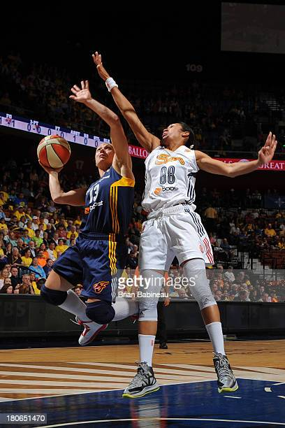 Erin Phillips of the Indiana Fever shoots against Iziane Castro Marques of the Connecticut Sun on September 15 2013 at the Mohegan Sun in Uncasville...