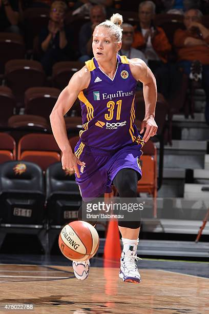 Erin Phillips of the Los Angeles Sparks brings the ball upcourt against the Connecticut Sun on May 28 2015 at Mohegan Sun Arena in Uncasville...