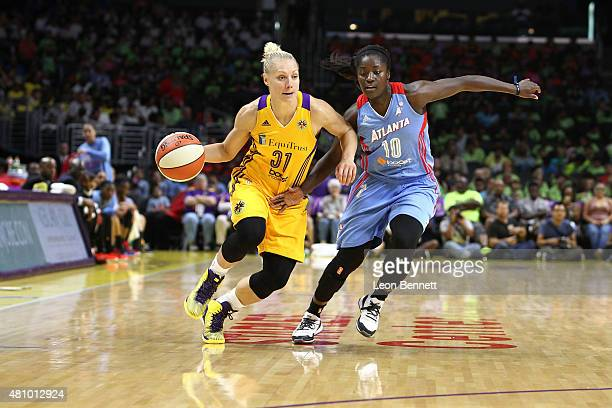 Erin Phillips of the Los Angeles Sparks handles the ball against Matee Ajavon of the Atlanta Dream in WNBA game at Staples Center on July 16 2015 in...