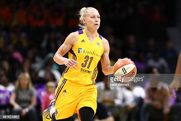 Erin Phillips of the Los Angeles Sparks handles the ball against the New York Liberty in a WNBA game at Staples Center on July 22 2015 in Los Angeles...