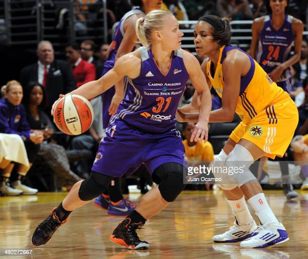 Erin Phillips of the Phoenix Mercury dribbles against Lindsey Harding of the Los Angeles Sparks at Staples Center on May 18 2014 in Los Angeles...