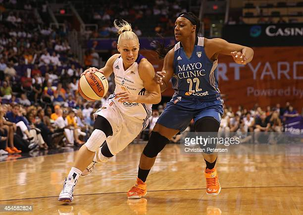 Erin Phillips of the Phoenix Mercury drives the ball past Monica Wright of the Minnesota Lynx during game three of the WNBA Western Conference Finals...