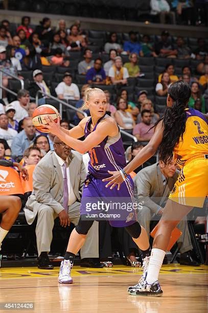 Erin Phillips of the Phoenix Mercury looks to pass the ball against Candice Wiggins of the Los Angeles Sparks in Game Two of the Western Conference...